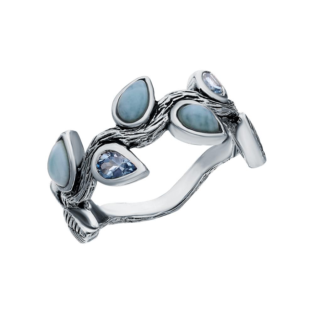 Фото «Серебряное кольцо с ларимаром и топазами»