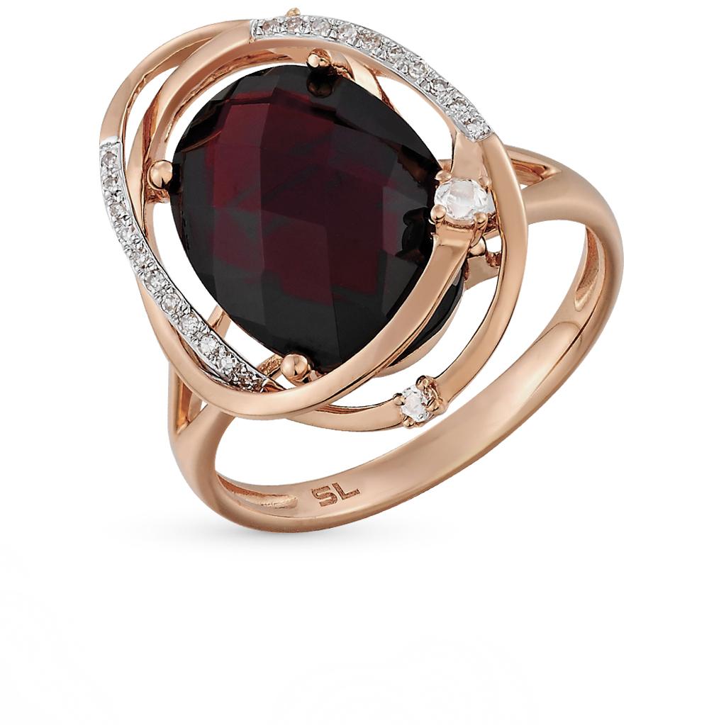 Золотое кольцо с топазами и гранатом в Екатеринбурге