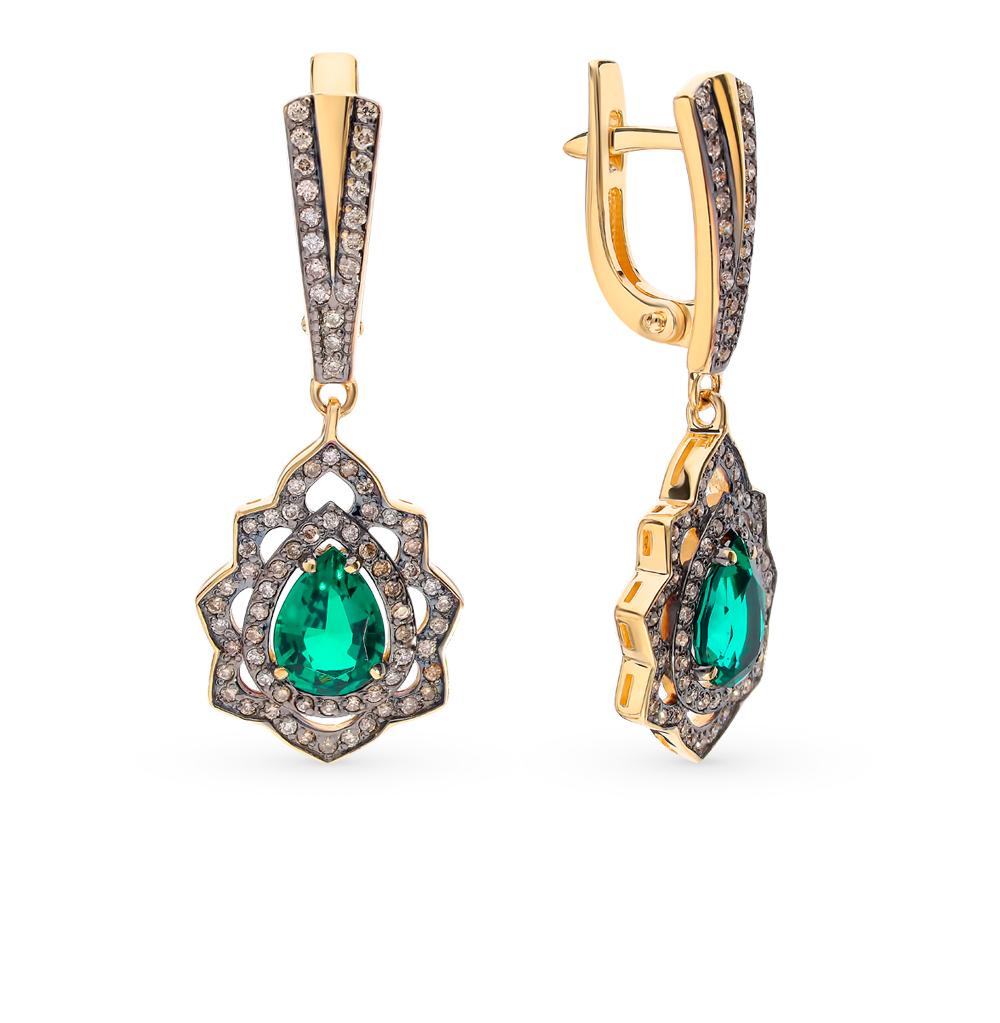 Фото «Золотые серьги с коньячными бриллиантами и изумрудами»