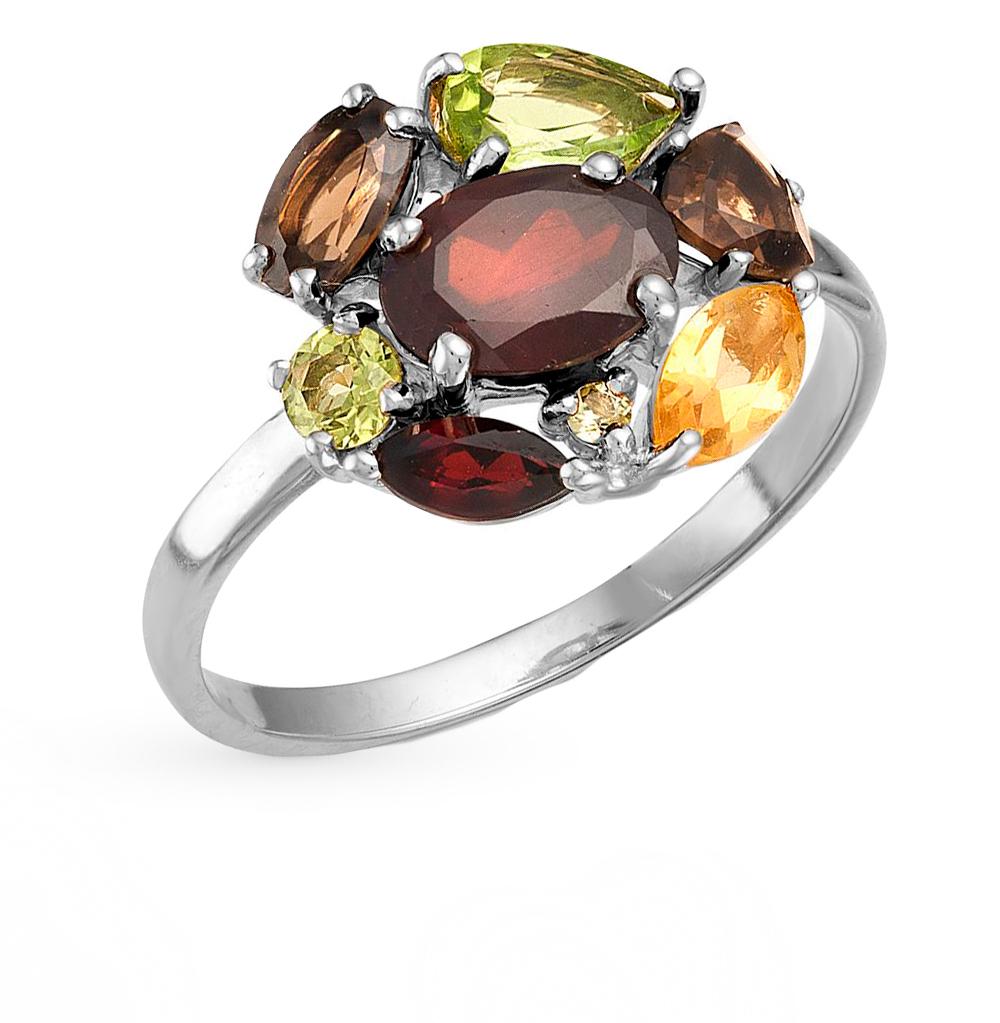 Фото «серебряное кольцо с гранатом, цитринами и хризолитом»