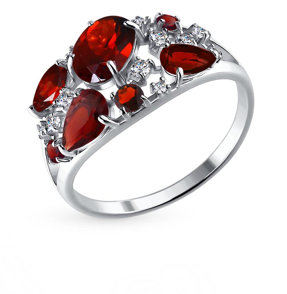 Фото «серебряное кольцо с гранатом и фианитами»