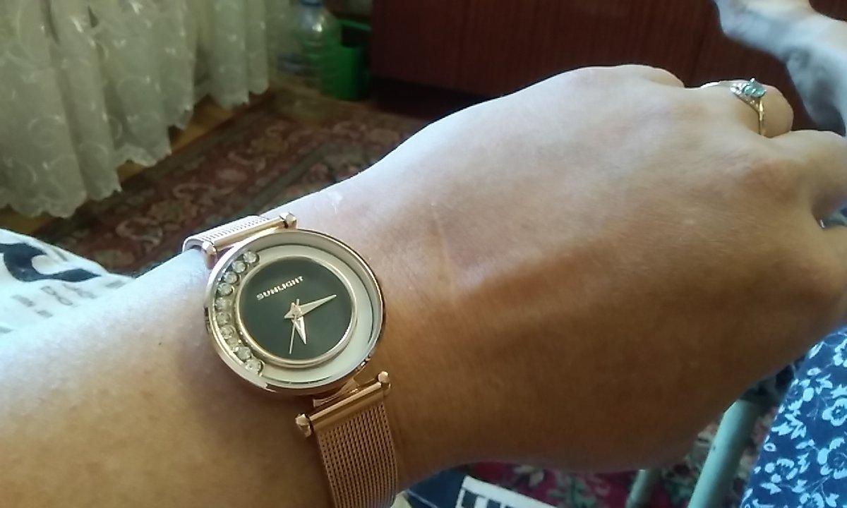 Часы Sanling.