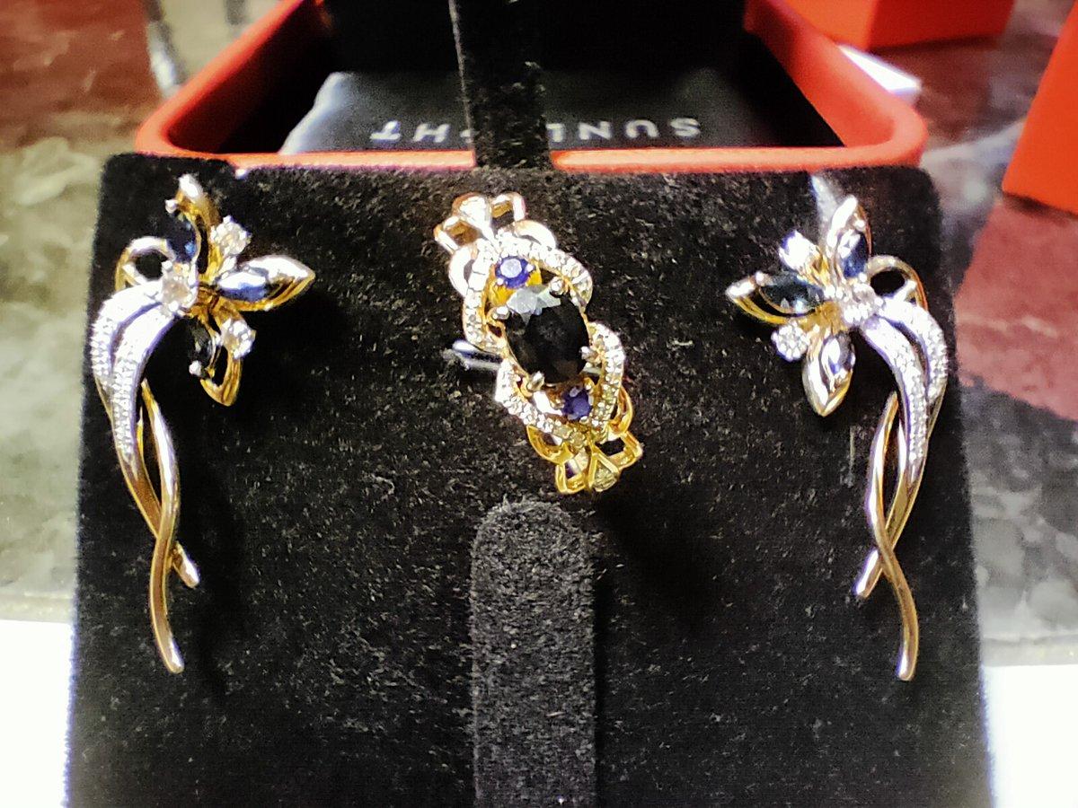 Серьги с бриллиантами, топазами и сапфирами.