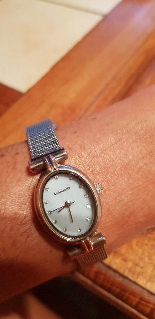 Часы овальные