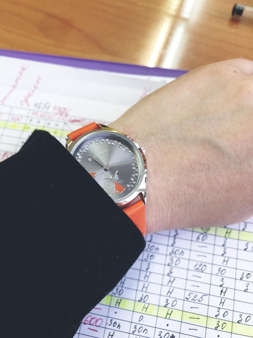 Часики с феей оранжевые.